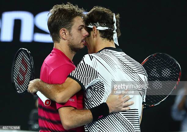 Stan Wawrinka of Switzerland congratulates Roger Federer of Switzerland on winning their semifinal match on day 11 of the 2017 Australian Open at...