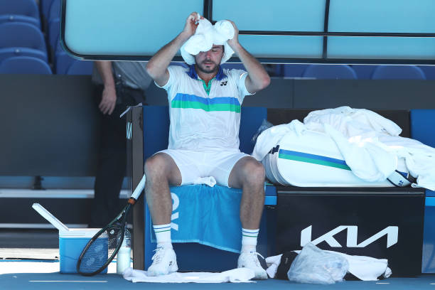 Stan Wawrinka of Switzerland cools down between games in his Men's Singles second round match against Marton Fucsovics of Hungary during day three of...