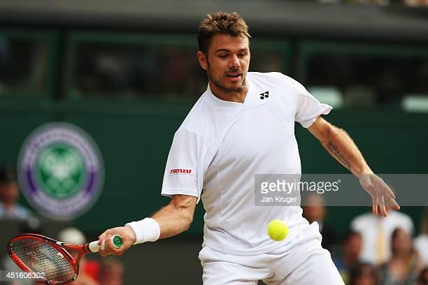 Stan Wawrinka of Switzerland during his Gentlemen's Singles quarterfinal match against Roger Federer of Switzerland on day nine of the Wimbledon Lawn...