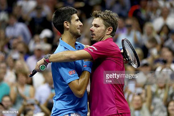 Stan Wawrinka of Switzerland embraces Novak Djokovic of Serbia after defeating him with a score of 67 64 75 63 during their Men's Singles Final Match...