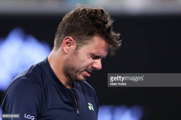 Stan Wawrinka of Switzerland grimaces after a point in his second round match against Tennys Sandgren of the United States on day four of the 2018...