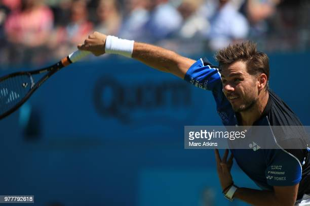 TOPSHOT Britain's Jay Clarke returns to US player Sam Querrey during their first round men's singles match at the ATP Queen's Club Championships...