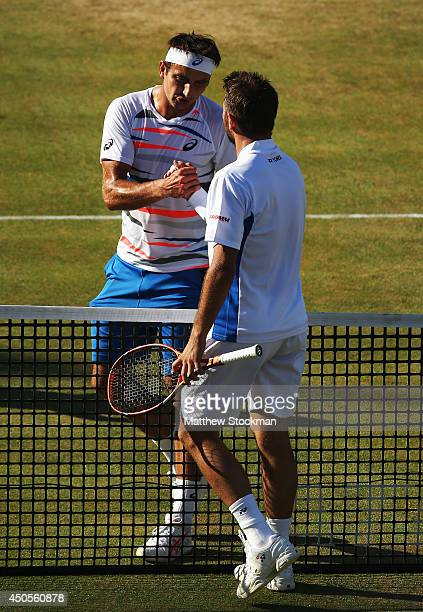 Stan Wawrinka of Switzerland is congratulated by Marinko Matosevic of Australia following their Men's Singles match on day five of the Aegon...