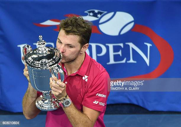 Stan Wawrinka of Switzerland kisses the championship trophy after defeating Novak Djokovic of Serbia in their 2016 US Open Men's Singles final match...