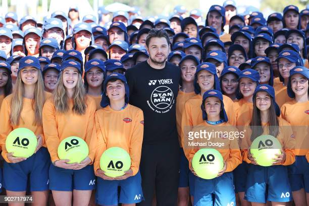Stan Wawrinka of Switzerland officially welcomes the Australian ball kids during a practice session ahead of the 2018 Australian Open at Melbourne...