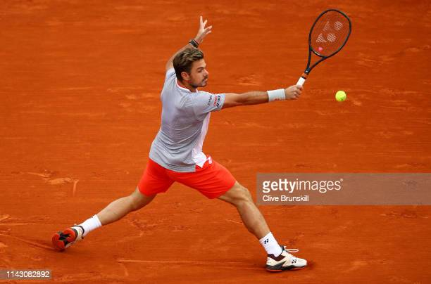 Stan Wawrinka of Switzerland plays a backhand against Marco Cecchinato of Italy in their second round match during day 3 of the Rolex MonteCarlo...