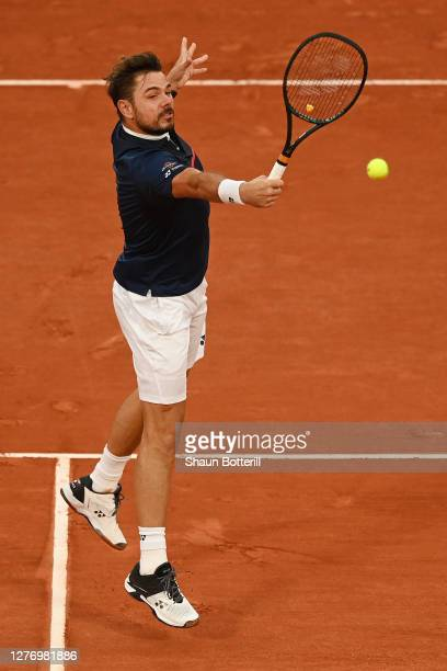 Stan Wawrinka of Switzerland plays a backhand during his Men's Singles first round match against Andy Murray of Great Britain during day one of the...