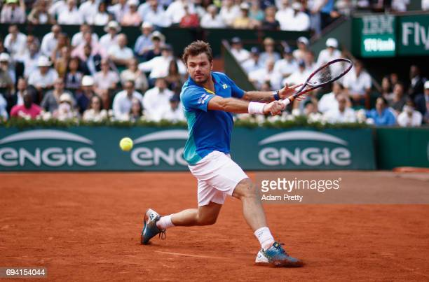 Stan Wawrinka of Switzerland plays a backhand during mens singles semifinal match against Andy Murray of Great Britain on day thirteen of the 2017...