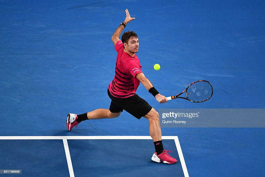 Stan Wawrinka of Switzerland plays a backhand in his first round match against Martin Klizan of Slovakia on day one of the 2017 Australian Open at Melbourne Park on January 16, 2017 in Melbourne, Australia.