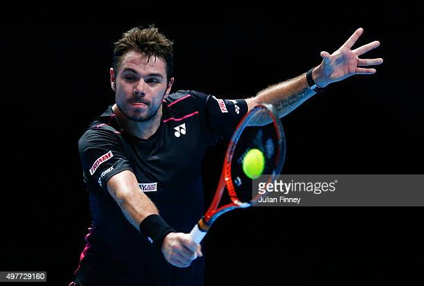 Stan Wawrinka of Switzerland plays a backhand in his men's singles match against David Ferrer of Spain during day four of the Barclays ATP World Tour...