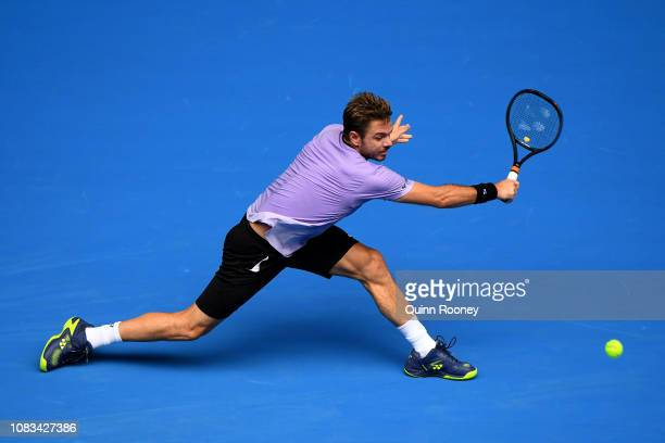 Stan Wawrinka of Switzerland plays a backhand in his second round match against Milos Raonic of Canada during day four of the 2019 Australian Open at...