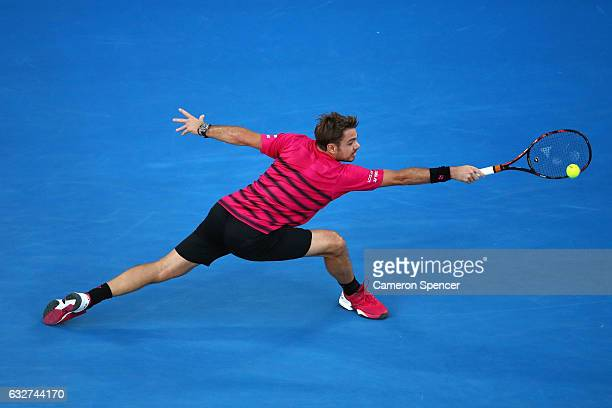 Stan Wawrinka of Switzerland plays a backhand in his semifinal match against Roger Federer of Switzerland on day 11 of the 2017 Australian Open at...