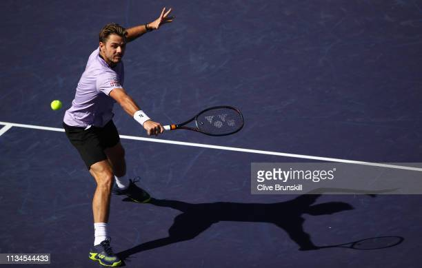 Stan Wawrinka of Switzerland plays a backhand volley against Dan Evans of Great Britain during their men's singles first round match on day five of...