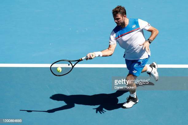Stan Wawrinka of Switzerland plays a forehand during his Men's Singles first round match against Damir Dzumhur of Bosnia and Herzegovina on day two...