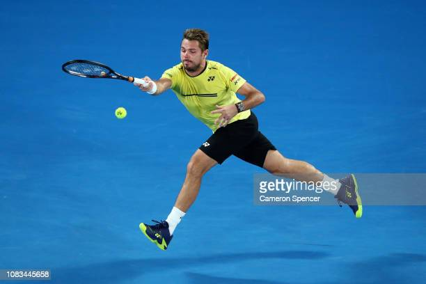 Stan Wawrinka of Switzerland plays a forehand in his second round match against Milos Raonic of Canada during day four of the 2019 Australian Open at...