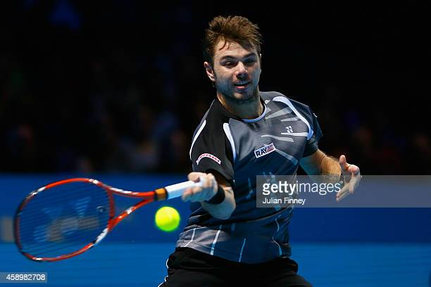 Stan Wawrinka of Switzerland plays a forehand in the round robin singles match against Marin Cilic of Croatia on day six of the Barclays ATP World...