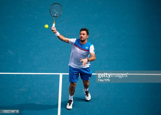 Stan Wawrinka of Switzerland plays a forehand volley in his fourth round match against Daniil Medvedev of Russia on day nine of the 2020 Australian...