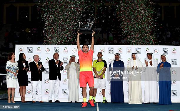 Stan Wawrinka of Switzerland raises the trophy after beating Marcos Baghdatis of Cyrus to win the ATP Dubai Duty Free Tennis Championship at the...