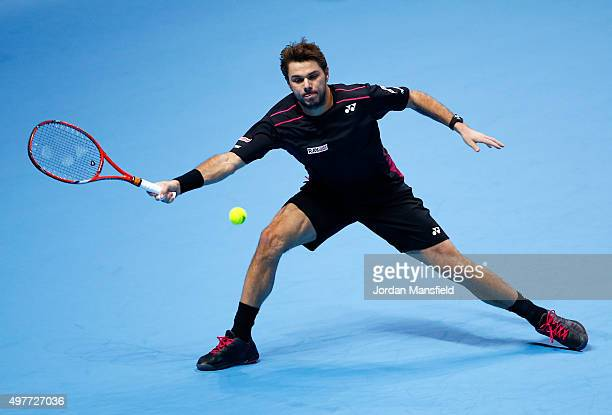 Stan Wawrinka of Switzerland reaches for a forehand in his men's singles match against David Ferrer of Spain during day four of the Barclays ATP...