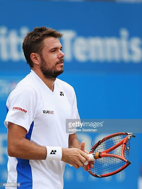 Stan Wawrinka of Switzerland reacts after damaging his racquet in his match against Grigor Dimitrov of Bulgaria during their Men's Singles semifinal...