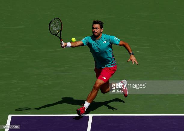 Stan Wawrinka of Switzerland returns a shot against Horacio Zeballos of Argentina during day 6 of the Miami Open at Crandon Park Tennis Center on...