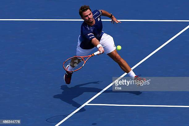 Stan Wawrinka of Switzerland returns a shot against Hyeon Chung of Korea during their Men's Singles Second Round match on Day Four of the 2015 US...