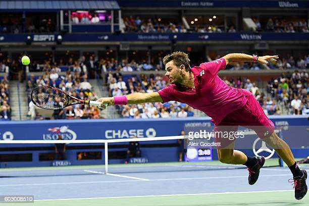 Stan Wawrinka of Switzerland returns a shot to Novak Djokovic of Serbia during their Men's Singles Final Match on Day Fourteen of the 2016 US Open at...