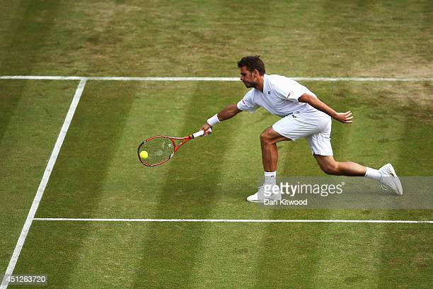 Stan Wawrinka of Switzerland returns the ball during his Gentlemen's Singles second round match against YenHsun Lu of Chinese Taipei on day four of...