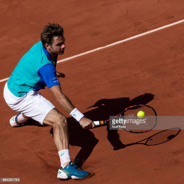 Stan Wawrinka of Switzerland returns the ball to Andy Murray of Great Britain during the semifinals at Roland Garros Grand Slam Tournament - Day 13...