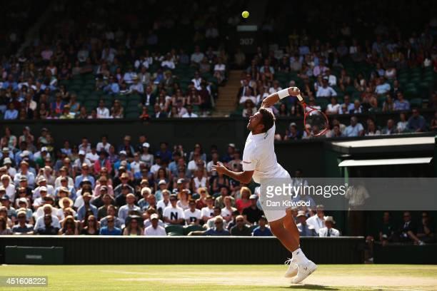 Stan Wawrinka of Switzerland serves during his Gentlemen's Singles quarterfinal match against Roger Federer of Switzerland on day nine of the...