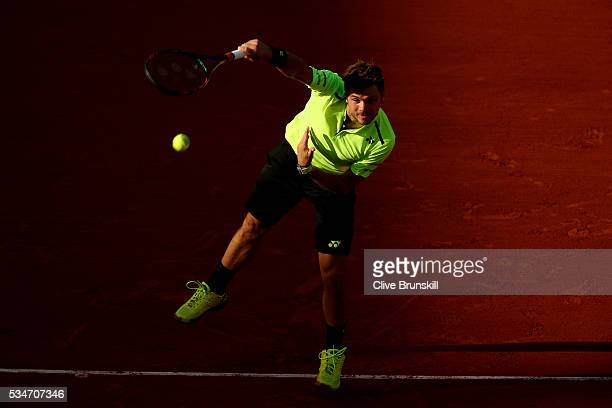 Stan Wawrinka of Switzerland serves during the Men's Singles third round match against Jeremy Chardy of France on day six of the 2016 French Open at...