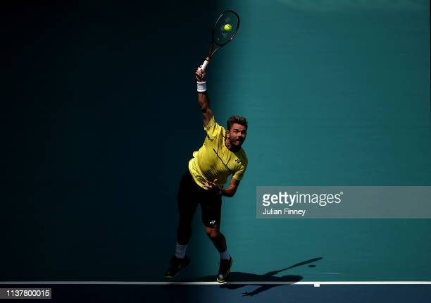 Stan Wawrinka of Switzerland serves to Filip Krajinovic of Serbia during the Miami Open Tennis on March 23 2019 in Miami Gardens Florida