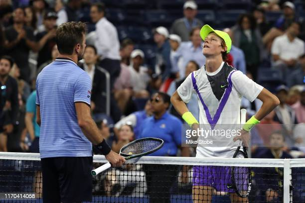 Stan Wawrinka of Switzerland shakes hands with Jannik Sinner of Italy after their Men's Singles first round match during day one of the 2019 US Open...