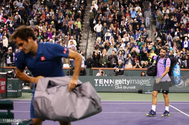 Stan Wawrinka of Switzerland shows his dejection as he walks off court after his straight sets defeat against Roger Federer of Switzerland during...