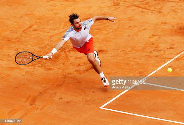 Stan Wawrinka of Switzerland stretches for a forehand during his first round match against David Goffin of Belgium during day three of the...
