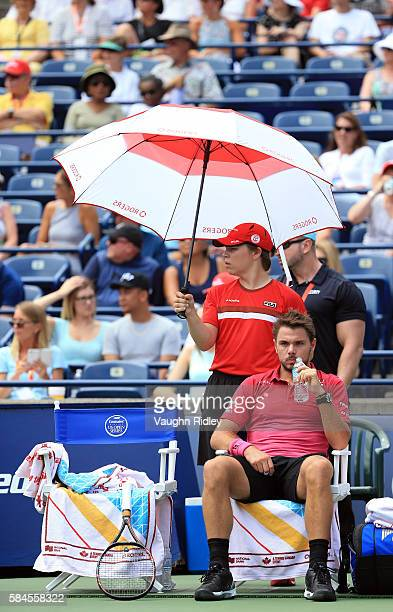 Stan Wawrinka of Switzerland takes a drink during a break in play against Kevin Anderson of South Africa during Day 5 of the Rogers Cup at the Aviva...
