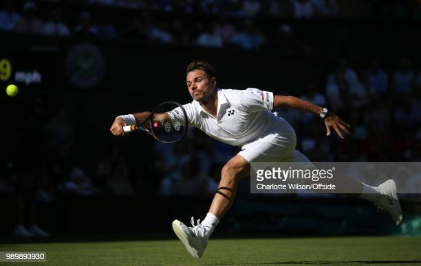 Stan Wawrinka v Grigor Dimitrov Stan Wawrinka stretches for the ball at All England Lawn Tennis and Croquet Club on July 2 2018 in London England