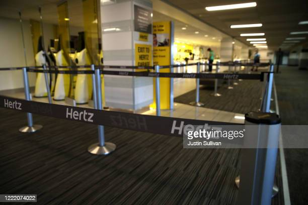 Stanchions with Hertz logo sit in an empty Hertz RentACar rental office at San Francisco International Airport on April 30 2020 in San Francisco...