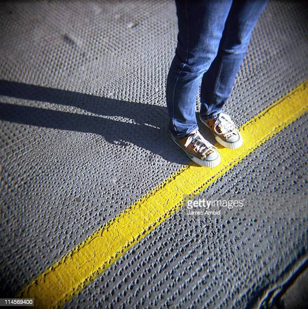 Stand behind yellow line