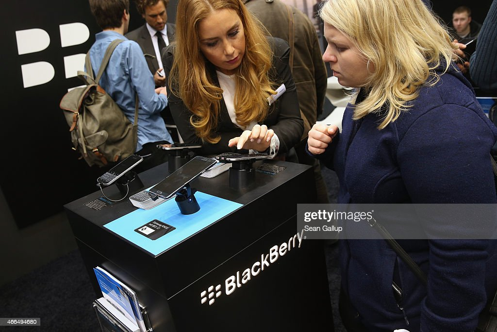 A stand hostess explains the functions of Blackberry's Secusmart security system at the Blackberry stand at the 2015 CeBIT technology trade fair on March 16, 2015 in Hanover, Germany. China is this year's CeBIT partner. CeBIT is the world's largest tech fair and will be open from March 16 through March 20.