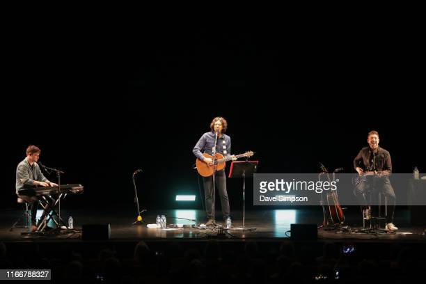 Stand in keyboard player Ryan McMullan singer Gary Lightbody and guitarist Nathan Connolly of Snow Patrol perform on stage at ASB Theatre Aotea...