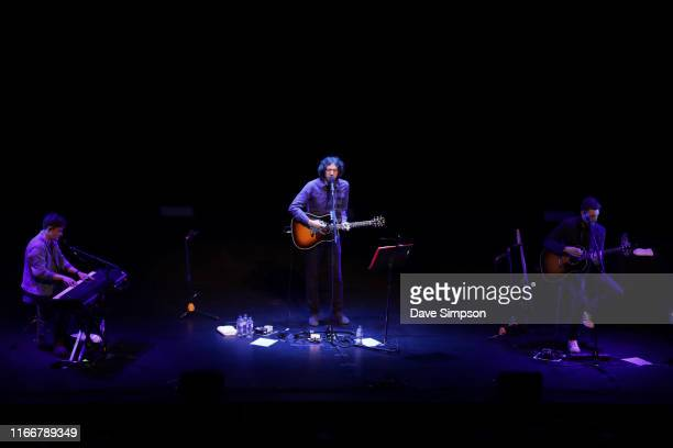 Stand in keyboard player Ryan McMullan singer Gary Lightbody and guitarist Nathan Connolly of Snow Patrol performs on stage at ASB Theatre Aotea...