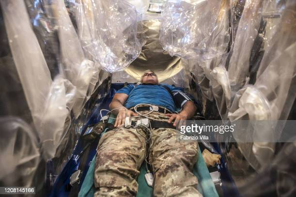 A stand in patient inside a Boeing KC767 during a Military exercise between Rome and Milan in which it was simulated the air transport of a patient...
