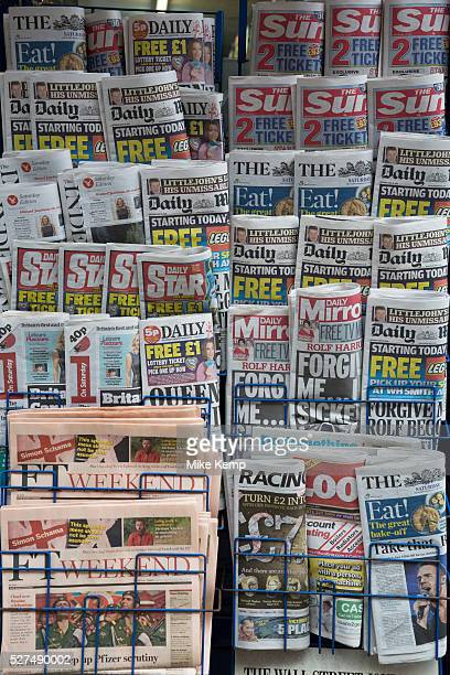 Stand of tabloid newspapers at a newsagents London UK The Sun ther Daily Mail The Star Daily Mirror predominantly