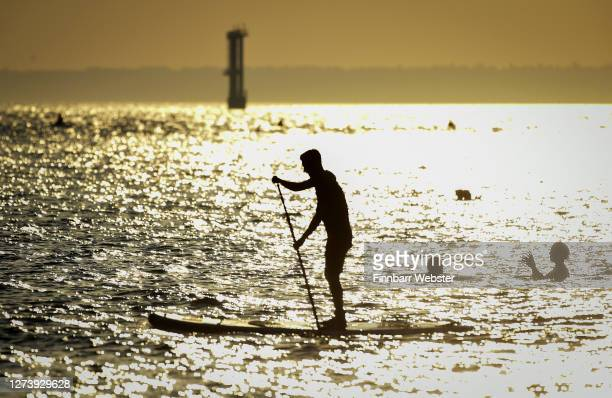 Stand up boarder in the evening sunshine on Southsea beach on September 21, 2020 in Portsmouth, England.