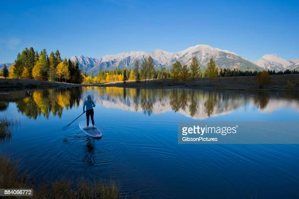 stand up paddleboard - aquatic sport stock pictures, royalty-free photos & images