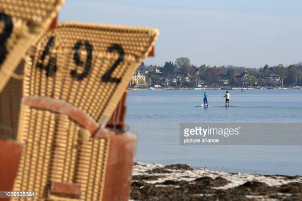 Stand up paddlers can be seen during sunshine on the Baltic Sea in Eckernfoerde Germany 7 May 2017 Photo Bodo Marks/dpa | usage worldwide