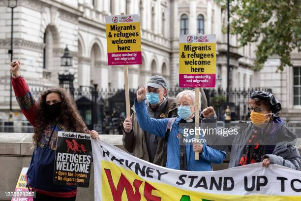 Stand Up To Racism organisation members protest against proposed by the government offshore detention centres for asylum seekers in front of Downing...