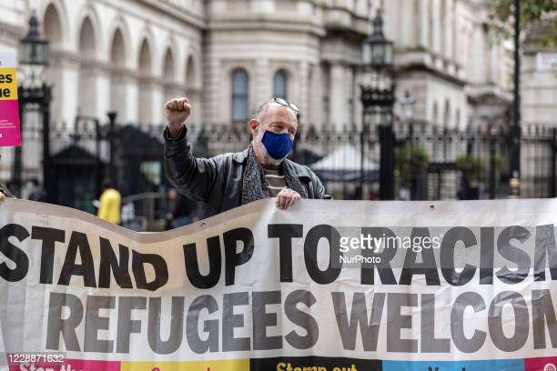 Stand Up To Racism organisation members protest againstproposed by the government offshore detention centres for asylum seekers in front of Downing...