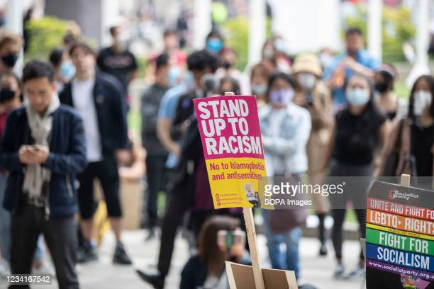 Stand up to Racism placards are seen outside Parliament Square during the Stop Asian Hate rally in London. Demonstrators held a protest against the...